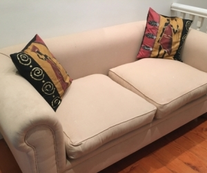 Large beige two seater sofa