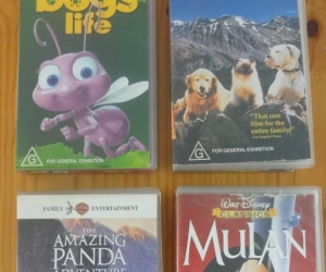 Four movies on VHS. Suit primary school child. Mulan,  Homeward Bound, A Bug's Life.
