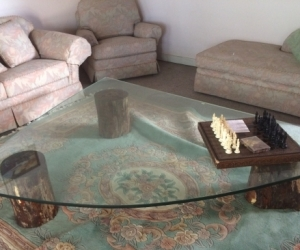 Large coffee table, antique glass on treated redwood stumps