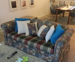 Three seater sofa bed and two easy chairs