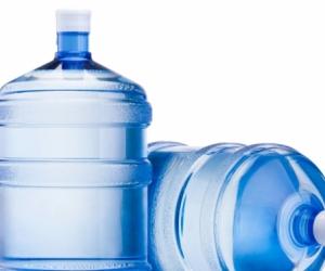 Empty water cooler bottle