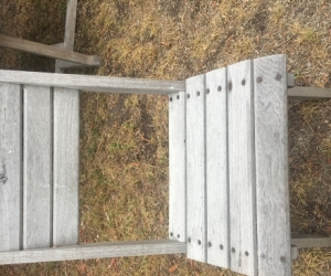6 outdoor timber chairs and foot stool.
