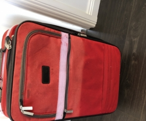 Red fabric suitcase