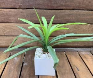 Decorative artificial strappy plant