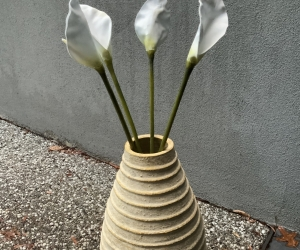 Vase with artificial white lillies