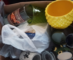 Box of old and new candles, wicks and containers - make recycled candles