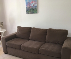 Fawn coloured large couch with Ottoman