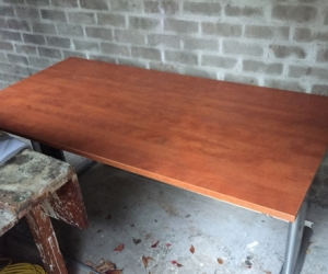 Large wooden desk with metal legs