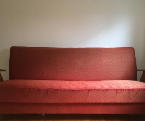 1950s red fold out sofa