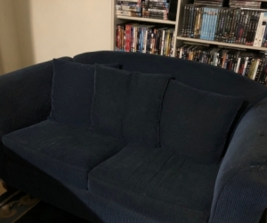 two blue couches two seater and two and half seater