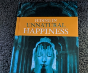 Hiding In Unnatural Happiness by Devamirita Swami
