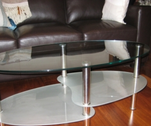 Oval Glass topped Coffee Table