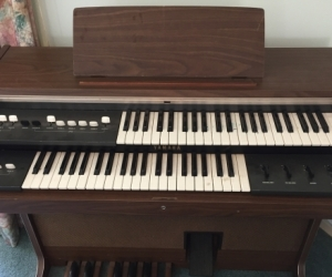 Organ with upper and lower keyboard and  foot base keys