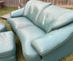 2 x green leather couches with foot rests