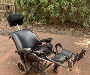 Tilt in space wheelchair