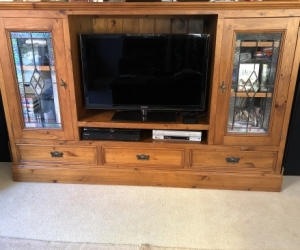 TV cabinet solid pine with lead light  doors in good condition.