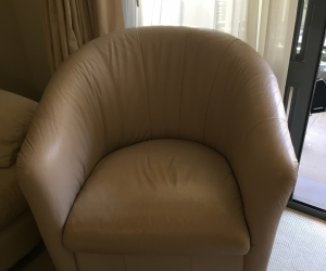 Leather curved swivel chair.