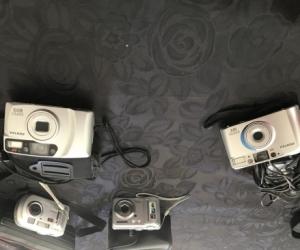 4 assorted digital and non digital cameras