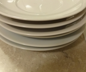 7 white saucers. Excellnt condition Good for cups or plant pot saucer