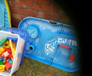 kids climbing frame, aqua play tray and a tub of boats etc