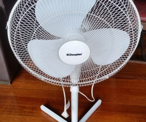 Dimplex oscillating fan on stand.