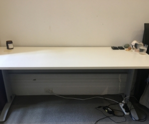 Modern white desk with cable holes