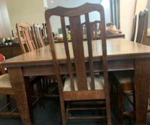Early 20th Century dinning table and 9 chairs. Made of Queensland maple/myrtle. Timber is unmarked but veneer shows signs of wear. Originally from the Federal Hotel Melbourne .