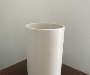 Simple white ceramic vase. 18cm tall.