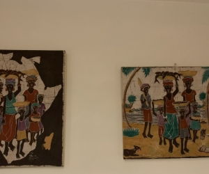Two African prints Cloth mounted on canvas
